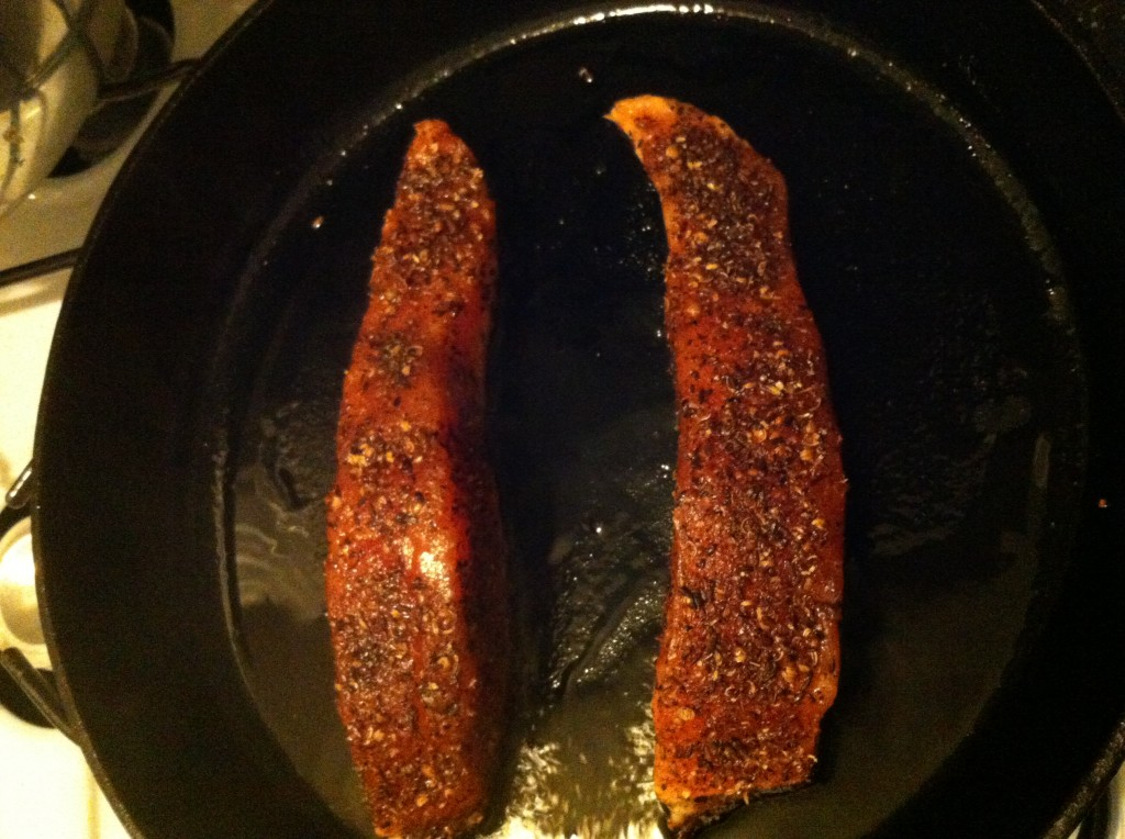 Spice-rubbed salmon searing